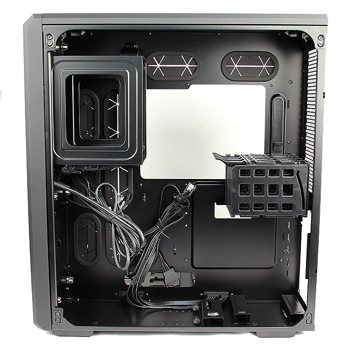 On the top left corner are the two bays for 5.25-inch drives, the cage above the PSU bay holds up to four 2.5-inch drives.