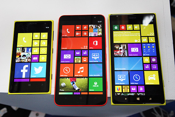 The new Nokia Lumia 1320 (center) and Lumia 1520 (right) smartphones feature a large 6-inch screen compared with the 4.5-inch Lumia 1020 (left). It's apparent from this that the new devices now feature an extra column of tiles that gives you even more space to put your favorite apps on your home screen.