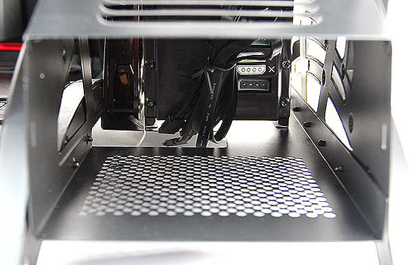 See the problem? Directly behind the PSU bay is the HDD cage, this means users would have to thread the cables either through the cut out below or through the sides, spilling directly onto the motherboard tray area.