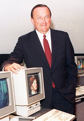 William C. Lowe in 1987, unveiling IBM's latest PC model. (Image Source: Richard Drew, Associated Press)
