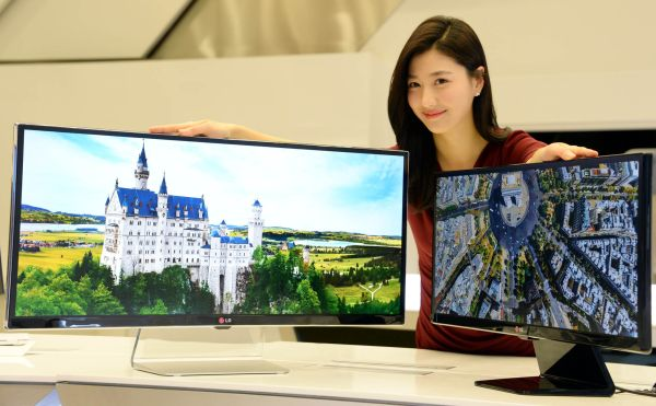 LG's latest and record-breaking Ultra Wide displays will be on display at CES 2014. On the right is LG's professional real 4K IPS display.