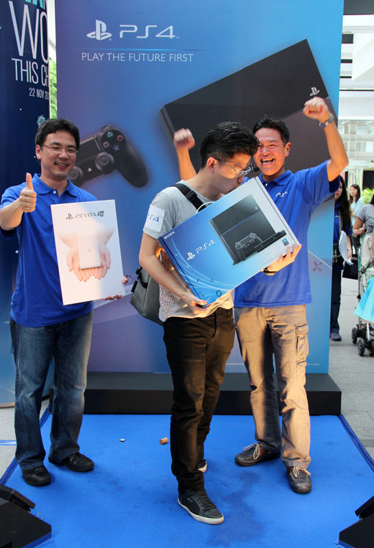 Mr. Aaron Tan was the first person in line to collect his PS4 pre-order today.