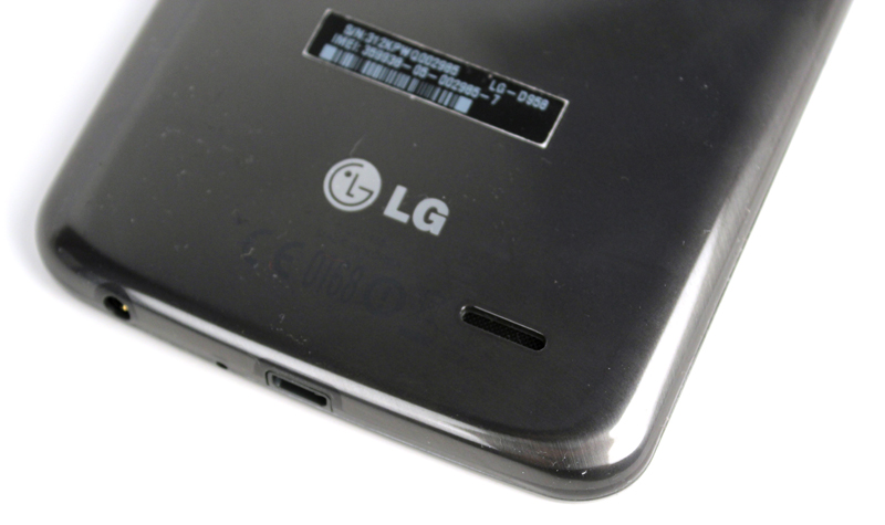 The G Flex's single speaker can be found on the lower-right rear of the device. Notice also the amount of dust clinging to the G Flex's rear.