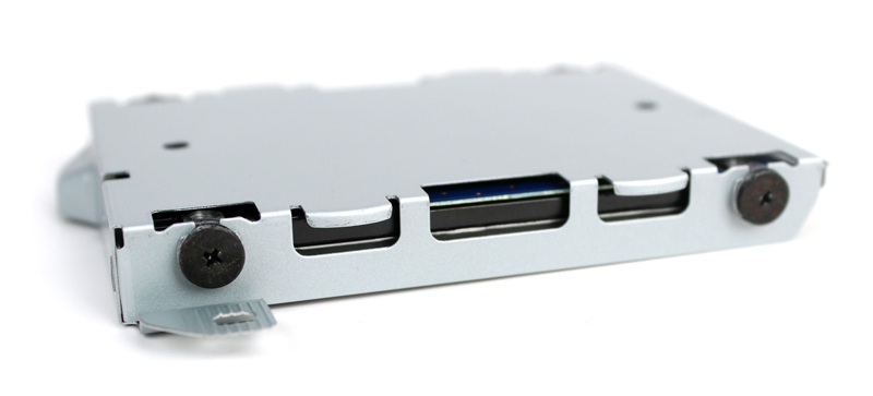 The HDD is mounted into its chassis via four black screws. Unscrew them and remove the HDD.