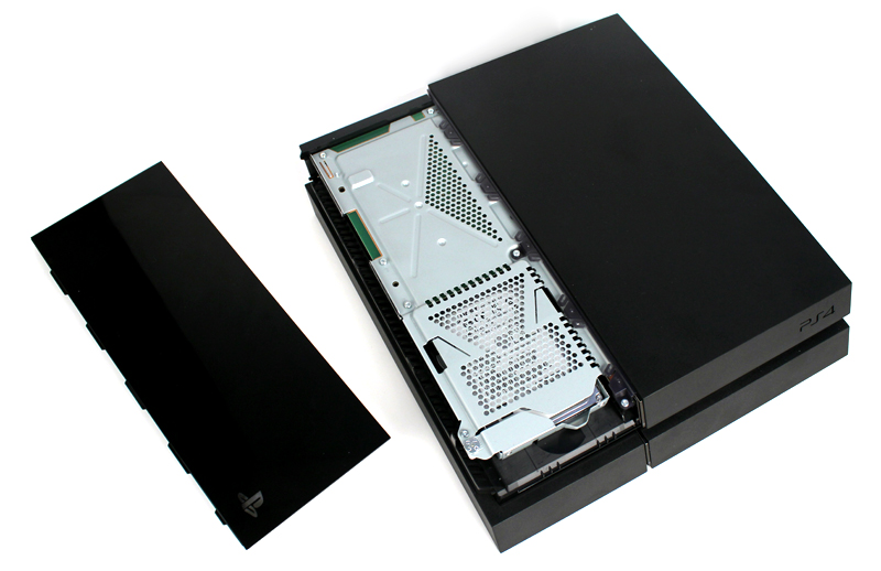 To install your new SSD, start by removing the PS4's HDD cover. This is the glossy panel on the top of the console - just slide it off.