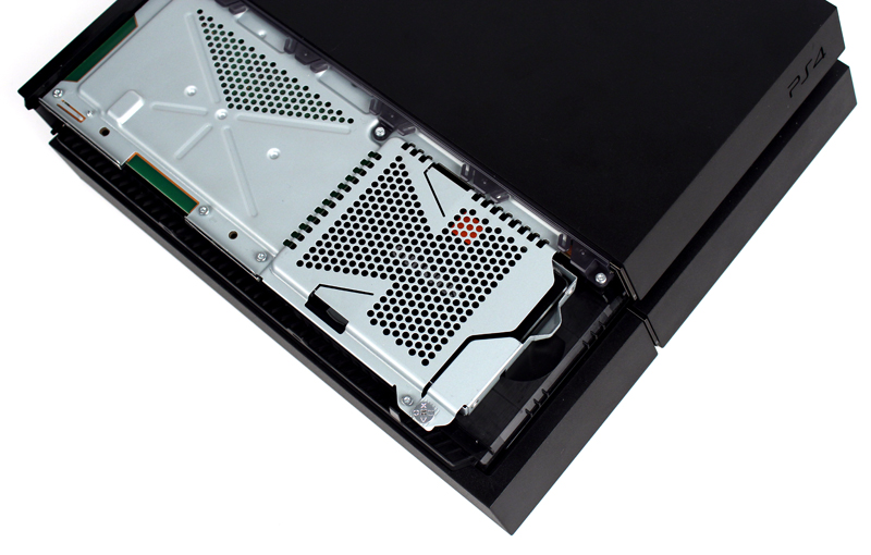 Slide the SSD back into the PS4 and replace the Playstation screw and drive cover.