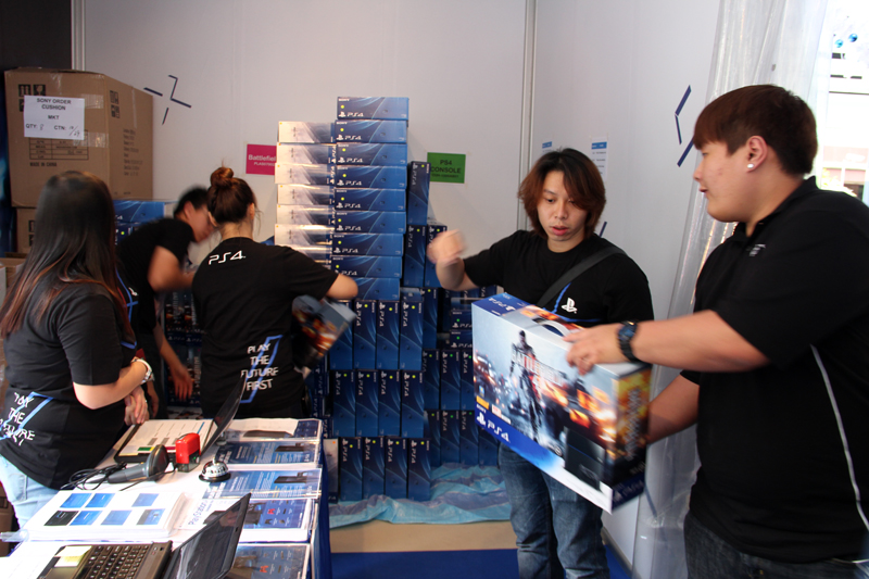 The Sony staff hard at work unloading all of the PS4 pre-order sets.