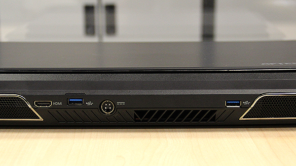 Towards the rear, in between the two exhaust vents are two more USB 3.0 ports, a HDMI port and the DC-in jack.