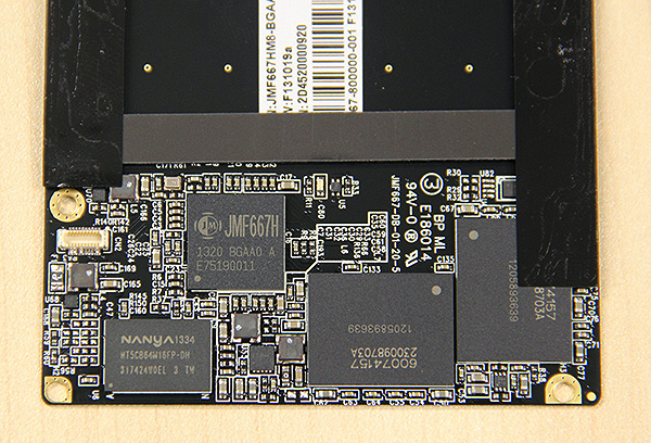 The JMicron 667H is to the left and to the bottom left of it is a Nanya DRAM chip for caching purposes. Capacity is provided for by two 64GB MLC NAND chips sourced from IMFT.