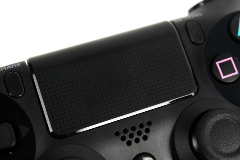 The clickable trackpad has a smooth finish, and feels similar to the rear touchpad on Sony's PS Vita.