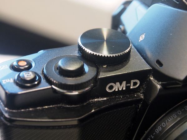 The E-M10 features twin control dials that are raised higher compared to those found on the E-M5, as well as a larger shutter release button.