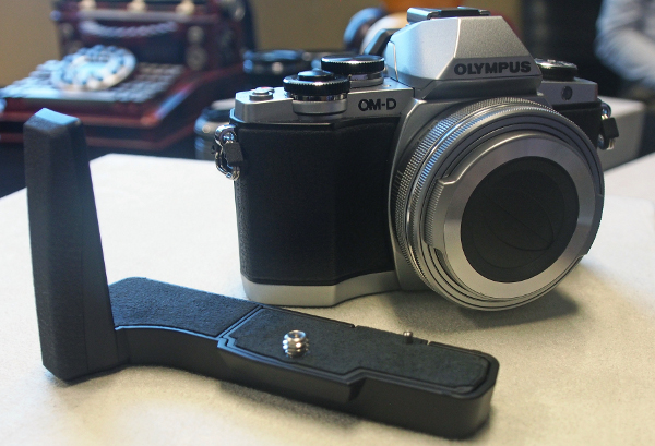 """There's also an optional grip for the OM-D E-M10, which not only extends the length of the grip, but also the depth. The grip however, is incapable of housing a battery, which is why Olympus made us promise to refer to it as just a """"grip"""" instead of the conventional and expected """"battery grip""""."""
