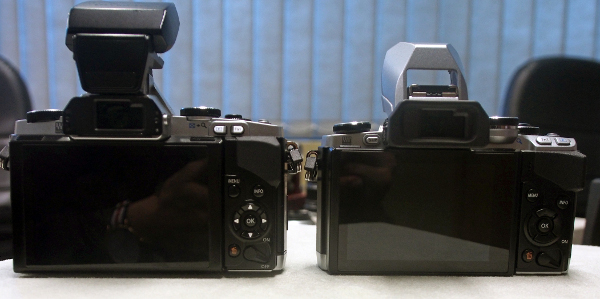 The button placement and button sizes on the rear of the E-M10 (right) are very similar to the E-M5, with the exception of the Playback button and Function button, which have swapped places but are still located at the top right.