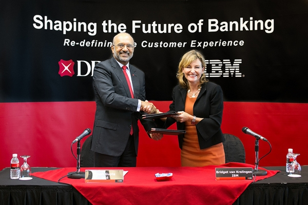 DBS CEO Piyush Gupta and Bridget van Kralingen, Senior Vice President, IBM Global Business Services, announcing the DBS-IBM collaboration. (Image Source: DBS)