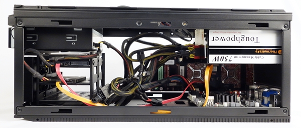 The PSU is mounted at the top of the chassis, over the mini-ITX board.
