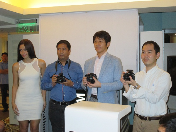 Fujifilm executives pose for the camera with the Fujifilm X-T1 interchangeable lens camera. The local launch coincides with the PhotoWorld Asia 2014.