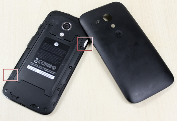 Removing the rear cover will let you access the two SIM card slots in the Moto G.