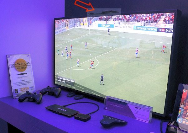 And here we've a full working demo of the featherweight AMD nano PC that's mounted on top of a TV as it powers a 1080p screen playing FIFA 14.