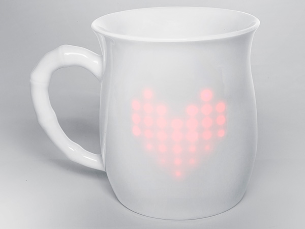 Smart coffee mug that connects to the onesie, so parents can be notified of the baby's condition.
