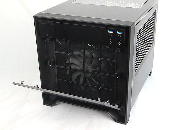 The aluminum front panel is secured by push latches and can be removed to access the front dust filter for the forward facing 140mm fan.