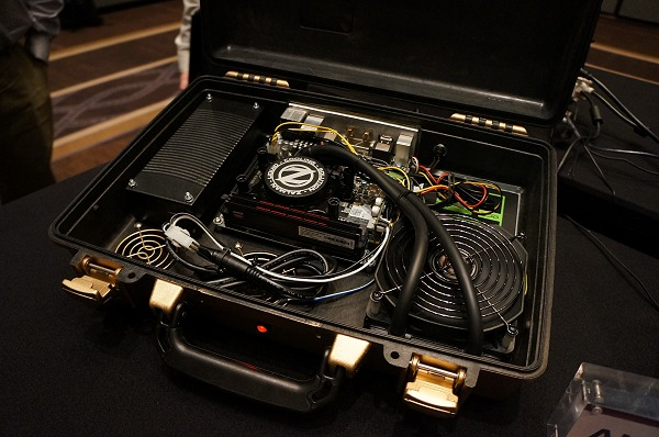 The briefcase PC is actually a custom PC-mod. With the advent of SSD drives, couriering over a briefcase PC overseas is certainly a feasible idea.