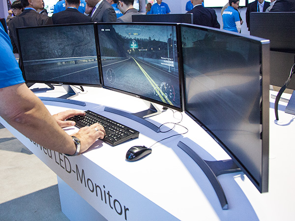 If you're a gamer, you'll need at least 3 to give you that immersive experience. Not that you can't achieve this with flat screen monitors, but you'll get a more seamless curve with this.