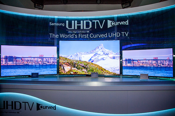 The new U9000 UHD TV series at 65-inches (right), 78-inches (center) and 55-inches (right).