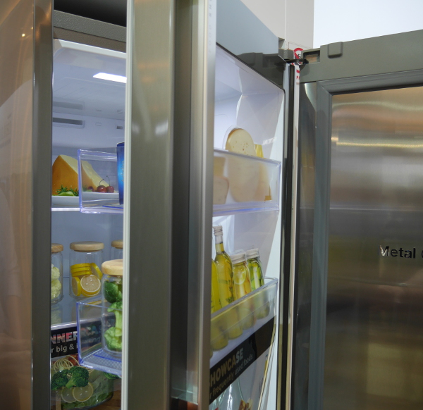 The ShowCase door, which provides easy access to food and condiments, while opening the main door reveals the usual drawer layout of a normal refrigerator.