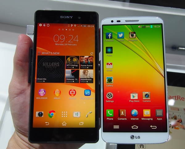 The Sony Xperia Z2 sports slimmer bezel than its predecessor. The LG G2 seen on its right has an ultra thin 2.65mm bezel.