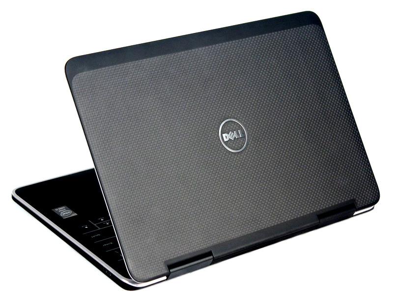 The machine's lid and bottom cover are protected by light but durable carbon fiber. The material's natural look also brings the Dell XPS a unique look, which is visible thanks to the use of transparent resin to hold the material together.