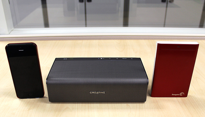 Just how big or small is the Sound Blaster Roar? Here it is next to an iPhone 5 and a regular portable external hard disk drive.