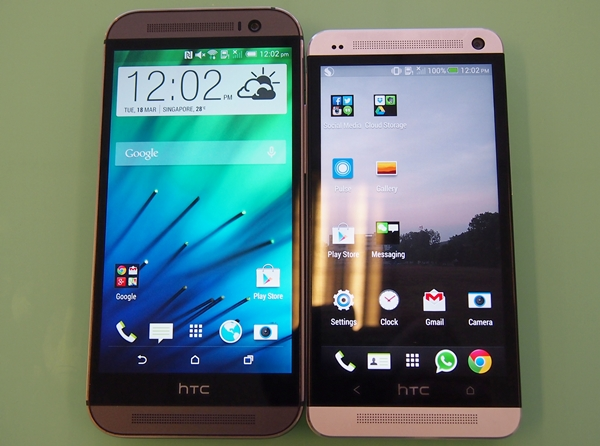 The HTC One (M8) retains some aspects of its design language from its predecessor (right) and the front-facing BoomSound speakers. Improved is the slimmer 'bezel' and its soft keys. Say goodbye to the dreaded fixed touch keys of the former HTC One series.