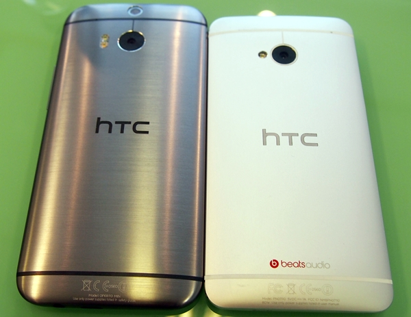 The Gunmetal Grey HTC One (M8) has a different finish and texture compared to the original HTC One (right).