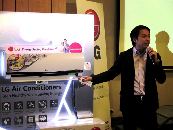 Operating the LG deluxe Inverter V air conditioner during the local launch.