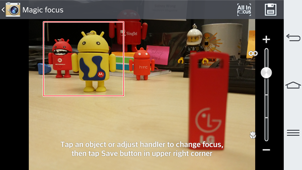 The objects highlighted in the box appear more in focus after we tapped on the red android toy.