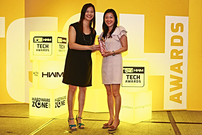 Logitech won the Readers' Choice awards for Best Keyboard Brand and Best Mouse Brand. Here's a smiling Ms. Shirley Neo, Logitech's Country Manager for Singapore, receiving the trophy.