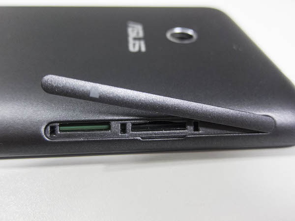 The micro-SIM card and microSD card slot is located through opening the flap on the left side of the phone.