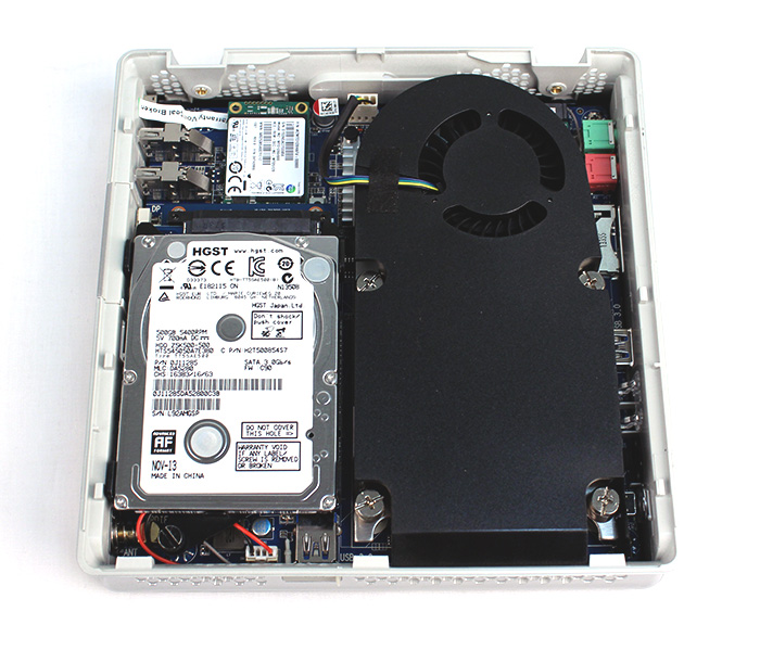 The Zotac ZBOX IQ01 with all the components installed. The memory SO-DIMM slots are under the 2.5-inch hard disk drive. As you can see, the cooler takes up bulk of the space. Fortunately, despite its size, it is pretty quiet.