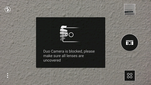 The phone will alert you if one of your fingers is blocking the Duo Camera.