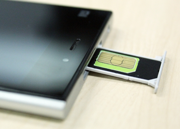 Most Android smartphones today use micro-SIM cards and the Xiaomi Mi 3 is an exception to the rule. It uses a standard sized SIM card. Seen here is a micro-SIM card in a black SIM card adapter.