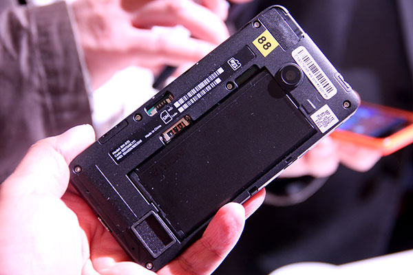 Pulling off the rear cover will give you access to the SIM and microSD card slots.