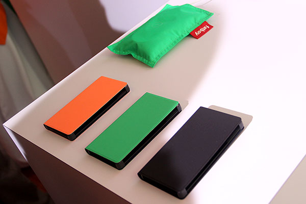 While you can't rip off and replace the rear shell of the Lumia 930, you can get a case for it. Comes in three colors: orange, green, and black.