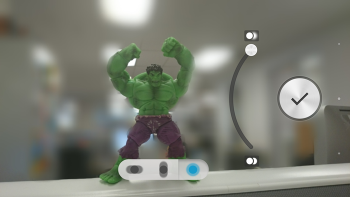 As you can see, the blur isn't perfect, and some areas like the Hulk's elbows have been blurred, despite being in the same focal plane as the rest of him. There's also quite an obvious outline around him where background details aren't blurred.