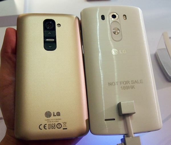The LG G3 (right) sports better designed rear buttons than its predecessor, the G2 (left).