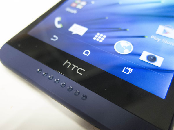 The soft buttons, as well as the front-facing BoomSound speakers are two staples in recent HTC phones.