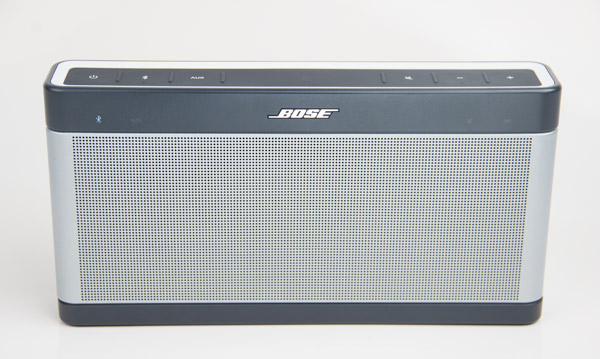 The front of the SoundLink III. Note the blue Bluetooth indicator light on the left, indicating it's in pairing.