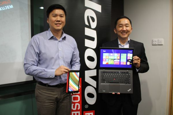 From L-R: Hon Kar Weng, Product Manager, Lenovo East Asia Region and Khoo Hung Chuan, Country General Manager, Lenovo Malaysia, posing with the Lenovo ThinkPad X1 Carbon and the Tablet 8.