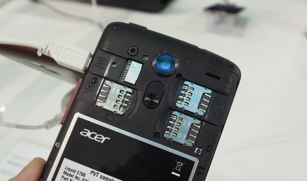 Removing the cover reveals three SIM slots and a microSD slot. However, the battery is built-in and cannot be removed.