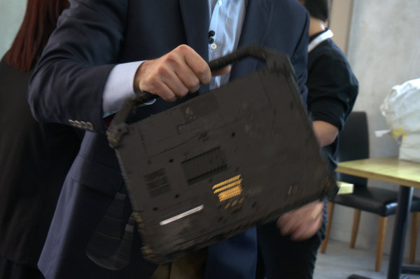 The Dell Latitude Rugged Extreme was held by its handle to shake off remaining water from the demo.