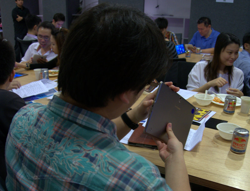 An attendee taking a good look at the physical features and design of the Samsung Galaxy Tab S (10.5) model.